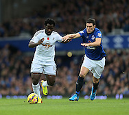 Everton's Gareth Barry tussles with Swansea's Wilfred Bony<br /> <br /> Barclays Premier League- Everton vs Swansea City - Goodison Park - England - 1st November 2014 - Picture David Klein/Sportimage
