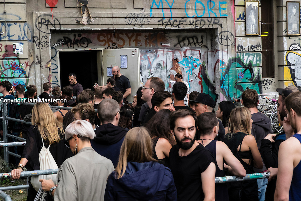 Clubbers queuing outside infamous Berghain nightclub on a Sunday afternoon in Berlin Germany - Editorial Use Only.