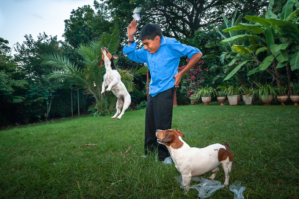 Nairobi, Kenya | 2007<br /> Kamran Fazal with his terriers, India and Hugo, at his home in 2007. He was born with a rare genetic disease called Spondylometaphyseal dysplasia Kozlowski type, which affects the growth of the spine. He died in 2011 at age 19, due to surgical complications, as he was preparing to attend university in Spain.