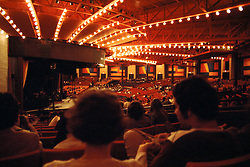 The View from mid left seating in the Old Westchester Music Theater and the back side of a few audience members heads. The theater itself and it's lovely lights! Just before 'The Band' performs at the Westchester Premier Theater on 13 July 1976