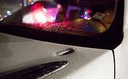 August 18, 2018 - Wellington, Florida, U.S. - A bullet pierced the hood of a vehicle driven by Robin Shecter, Wellington, who was pulling into Palm Beach Central high School to pick up children. Two adults were shot Friday night at a football game between Palm Beach Central and William T. Dwyer high schools, authorities said. The gunfire sent players and fans screaming and stampeding in panic during the fourth quarter of the game at Palm Beach Central High School in Wellington, Florida on August 17, 2018. (Credit Image: © Allen Eyestone/The Palm Beach Post via ZUMA Wire)