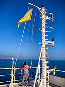 24 Set 2020 - A yellow flag is hoisted while entering Mexican waters as sign of vessel under quarantine while waiting for the medial inspection.