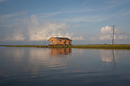 Abandoned fishing camp in the marsh between  Isle de Jean Charles and Pointe-Aux-Chien in Terribone Parish Louisiana. The Island is under constant threat of flooding due to coastal erosion.