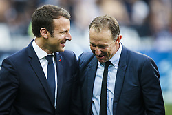 May 27, 2017 - Saint-Denis, Paris, France - French President Emmanuel Macron (L) and French former football player and coach Jean-Pierre Papin (C) smile as they arrive prior to the French Cup final football match between Paris Saint-Germain (PSG) and Angers (SCO) on May 27, 2017, at the Stade de France in Saint-Denis, north of Paris. (Credit Image: © Geoffroy Van Der Hasselt/NurPhoto via ZUMA Press)