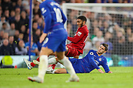 Liverpool defender Joe Gomez (12) is slide tackled by Chelsea forward Alvaro Morata (29) during the Premier League match between Chelsea and Liverpool at Stamford Bridge, London, England on 29 September 2018.