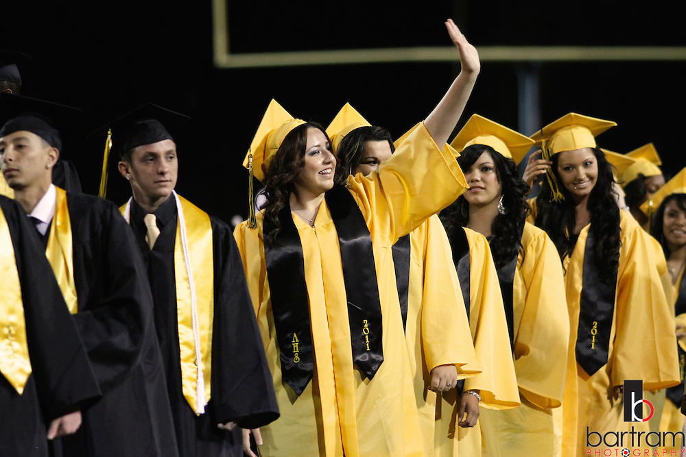 Solmayra Gutierrez waves while waiting to receive her diploma during Antioch High School graduation on Friday, June 10, 2011 in Antioch. (Photo by Kevin Bartram)