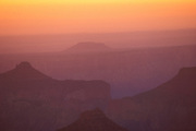 Hazy sunrise over the Grand Canyon from Point Imperial, North Rim, Grand Canyon National Park, Arizona.