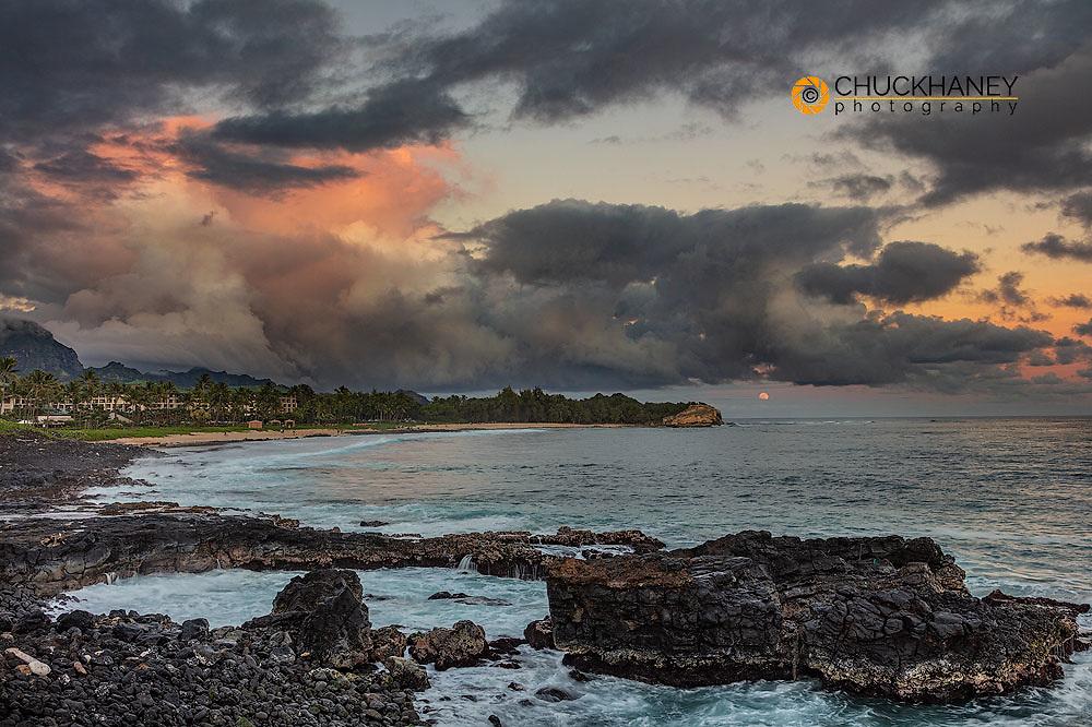 Sunset clouds over Shipwreck Beach in Poipu in Kauai, Hawaii, USA