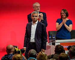 © Licensed to London News Pictures. 27/09/2016. Liverpool, UK. Labour party leader JEREMY CORBYN watches on as Mayor of London SADIQ KHAN waves to the crowd after delivering a speech at the third day of the Labour Party Annual Conference, held at the ACC in Liverpool, merseyside, UK. Photo credit: Ben Cawthra/LNP