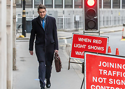 """© Licensed to London News Pictures. 25/02/2021. London, UK. Education Minister Gavin Williamson arrives at his office this in Westminster, London this morning as he makes plans for school's A Levels and GCSE exams to be voluntarily and give teachers control over grades as the government orders all schools back by 8th March 2021. <br /> This week, Prime Minister Boris Jonson announced his """"Roadmap Map' out of Lockdown with a gradual easing of Covid-19 restrictions with shops, pubs and gyms to open by April, Rule of Six and schools back by March and nightlife back by June. Photo credit: Alex Lentati/LNP"""
