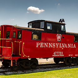 New Freedom, PA – June 25, 2016: A bright red Pennsylvania Rail Road caboose near the New Freedom Train Station.