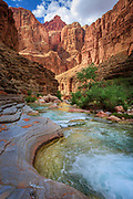 "Havasu Creek is a side stream to the Colorado River in the interior of the Grand Canyon<br /> .....<br /> The Grand Canyon is a steep-sided canyon carved by the Colorado River in the state of Arizona in the United States. It is contained within and managed by Grand Canyon National Park, the Hualapai Tribal Nation, the Havasupai Tribe and the Navajo Nation. President Theodore Roosevelt was a major proponent of preservation of the Grand Canyon area, and visited it on numerous occasions to hunt and enjoy the scenery.<br /> The Grand Canyon is 277 miles long, up to 18 miles wide and attains a depth of over a mile. Nearly two billion years of Earth's geological history have been exposed as the Colorado River and its tributaries cut their channels through layer after layer of rock while the Colorado Plateau was uplifted. While the specific geologic processes and timing that formed the Grand Canyon are the subject of debate by geologists, recent evidence suggests that the Colorado River established its course through the canyon at least 17 million years ago. Since that time, the Colorado River continued to erode and form the canyon to its present-day configuration.<br /> For thousands of years, the area has been continuously inhabited by Native Americans who built settlements within the canyon and its many caves. The Pueblo people considered the Grand Canyon (""Ongtupqa"" in the Hopi language) a holy site, and made pilgrimages to it. The first European known to have viewed the Grand Canyon was García López de Cárdenas from Spain, who arrived in 1540."