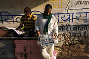 Men reading newspapers on the street, Jaipur, India