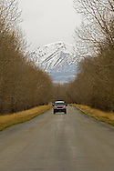 The road to Melville Montana with Crazy Mountains in background, <br /> MODEL RELEASED, PROPERTY RELEASED