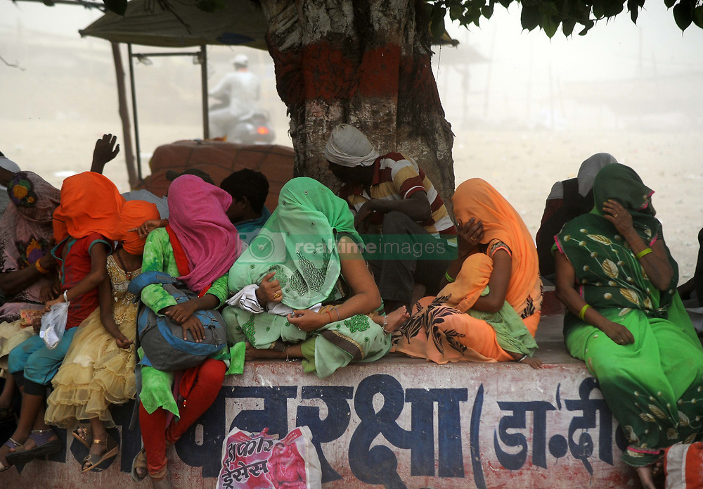 June 16, 2017 - Allahabad, Uttar Pradesh, India - Indian women cover their face with colthe to being safe from dust storm at the Sangam, the confluence of the Ganges, Yamuna and mythical Saraswati rivers in Allahabad. (Credit Image: © Prabhat Kumar Verma via ZUMA Wire)