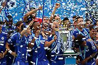 Football - 2014 / 2015 Premier League - Chelsea vs. Sunderland.   <br /> <br /> Chelsea players on the podium celebrate lifting the Premier League trophy at Stamford Bridge<br /> <br /> COLORSPORT/DANIEL BEARHAM