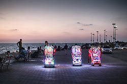 Boys offering illuminated prams for hire on the sea front in Gaza City. From a series of photos commissioned by  British NGO, Medical Aid for Palestinians (MAP).