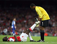 Photo: Chris Ratcliffe.<br /> Arsenal v FC Porto. UEFA Champions League, Group G. 26/09/2006.<br /> Emmanuel Eboue of Arsenal receives some help for an injury from Porto keeper Helton.