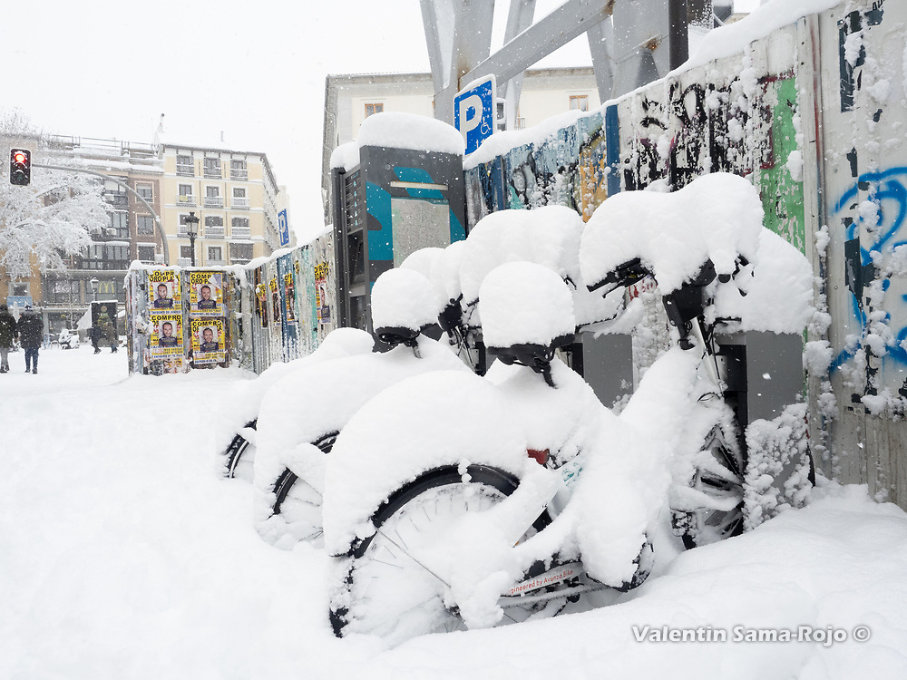 Madrid, Spain. 9 th January, 2021. Bicicles of 'BiciMad' service covered with snow. Storm Filomena hits Madrid (Spain), a weather alert was issued for cold temperatures and heavy snow storms across Spain; according to the weather agency Aemet is expected to be one of the snowiest days in recent years. © Valentin Sama-Rojo.