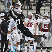 ORLANDO, FL - NOVEMBER 14:  Richie Grant #27 of the Central Florida Knights attempts to break up a pass to Jadan Blue #5 of the Temple Owls at Bounce House-FBC Mortgage Field on November 14, 2020 in Orlando, Florida. (Photo by Alex Menendez/Getty Images) *** Local Caption *** Richie Grant; Jadan Blue