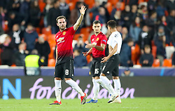 Manchester United's Juan Mata waves to the fans after the final whistle