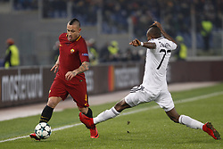December 5, 2017 - Rome, Italy - Roma s Radja Nainggolan, left, is challenged by Qarabag s Donald Guerrier during the Champions League Group C soccer match between Roma and Qarabag at the Olympic stadium. Roma won 1-0 to reach the round of 16. (Credit Image: © Riccardo De Luca/Pacific Press via ZUMA Wire)