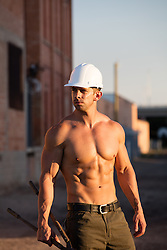sexy shirtless construction worker outdoors