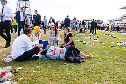 © Licensed to London News Pictures. 5/11/2013. A women sleeps while her friends have a conversation during Melbourne Cup Day at Flemington Racecourse on November 5, 2013 in Melbourne, Australia. Photo credit : Asanka Brendon Ratnayake/LNP