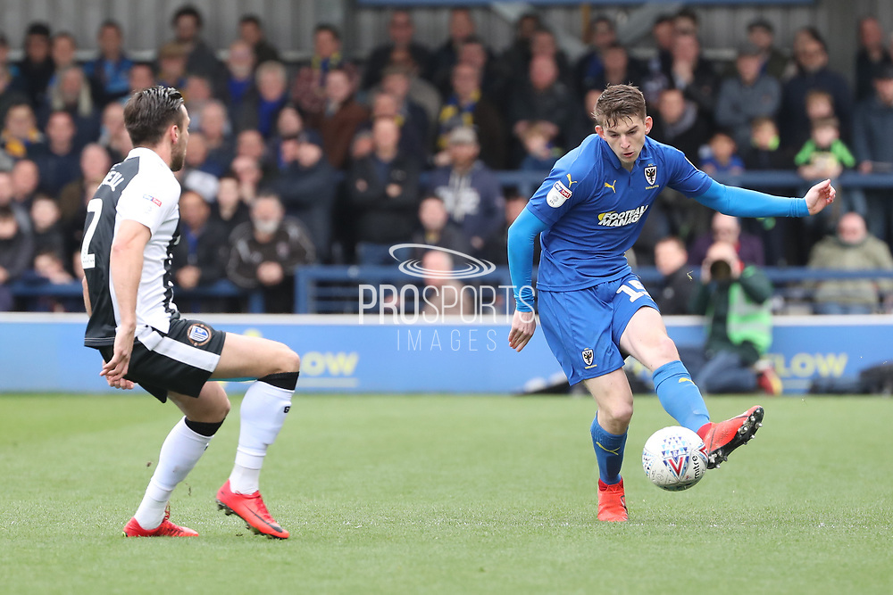 AFC Wimbledon defender Steve Seddon (15) passing the ball around \g2 during the EFL Sky Bet League 1 match between AFC Wimbledon and Gillingham at the Cherry Red Records Stadium, Kingston, England on 23 March 2019.