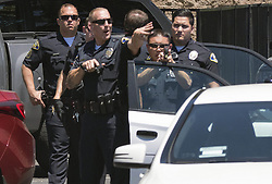 June 26, 2017 - Anaheim, CA, USA - Police prepare to approach a car after a pursuit and the arrest a man driving a white Mercedes through Anaheim, CA on Monday, June 26, 2017. The vehicle theft suspect called 911 during the pursuit to inform police he would be driving to the police station. (Credit Image: © Ken Steinhardt/The Orange County Register via ZUMA Wire)