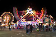 Oct 14, 2008 -- PHOENIX, AZ: The G Force is flanked by Ferris wheels at the Arizona State Fair. The Arizona State Fair started Oct.  10 and runs through Nov. 2. Carnival and midway workers who have worked the fair for years say attendance so far is much lower than in the past and people at the fair this year aren't spending as much money as they have in the past. Photo by Jack Kurtz / ZUMA Press