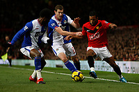 Photo: Steve Bond/Richard Lane Photography. Manchester United v Blackburn Rovers. Barclays Premiership 2009/10. 31/10/2009. Nani (r) attacks Pascal Chimbonda (L) and Brett Emerton (C)