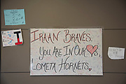 A sign of support from Lometa High School hangs in the hallway at Iraan High School in Iraan, Texas on December 13, 2016. (Cooper Neill for The New York Times)