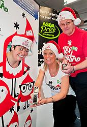 Text Santa  Charity Campaign Launch People Manager Sue Stringer with Asda collueuages John Somerville (right) and Jess Langan (left) Barrow Road Asda Harrogate. .www.pauldaviddrabble.co.uk.6 December 2011  Image © Paul David Drabble