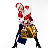 young beautiful woman dressed with santa claus costume preparing christmas shopping