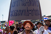 """14 JANUARY 2014 - BANGKOK, THAILAND:  Thai anti-government protestors at Victory Monument. Tens of thousands of Thai anti-government protestors continued to block the streets of Bangkok Tuesday to shut down the Thai capitol. The protest, """"Shutdown Bangkok,"""" is expected to last at least a week. Shutdown Bangkok is organized by People's Democratic Reform Committee (PRDC). It's a continuation of protests that started in early November. There have been shootings almost every night at different protests sites around Bangkok, but so far Shutdown Bangkok has been peaceful. The malls in Bangkok are still open but many other businesses are closed and mass transit is swamped with both protestors and people who had to use mass transit because the roads were blocked.    PHOTO BY JACK KURTZ"""