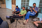 Members of the Free Syrian Army (FSA) appears to be conducting an induction of their weapons in Anadan on Monday, June 25, 2012. Anadan bears the scars from Syrian President Bashar al-Assad's use of military force to crush an opposition movement that has spawned an armed insurgency against his rule. (Photo by Vudi Xhymshiti)