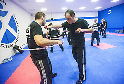 Punching over the hoop, Stef Noij, KMG Instructor from the Institute Krav Maga Netherlands, at the IKMS G Level Programme seminar today at the Scottish Martial Arts Centre, Alloa.