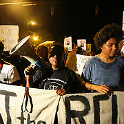 Charlotte, NC- September 23, 2016:  Protestors continue down Caldwell Street on the third night of protests in Charlotte, NC. CREDIT: LOGAN R. CYRUS FOR THE NEW YORK TIMES