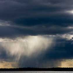 Rainshowers in the distance as seen from Long Beach in Stratford, Connecticut.  Adjacent to the Great Meadows Unit of McKinney National Wildlife Refuge.