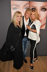 Left to right, JO WOOD, GARY COCKERILL and JILLY JOHNSON at the launch of Simply Glamorous by Gary Cockerill held at Alon Fine Art, 5-7 Dover Street, London on 16th September 2015.
