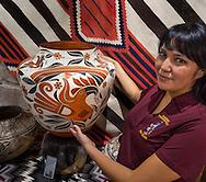 Savannah Means shows a Acoma pot at The Gallery, Cameron Trading Post, Cameron, Arizona