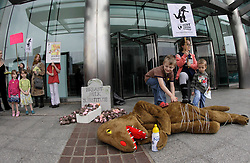 © Licensed to London News Pictures. 19/05/2012, London, UK.  A 'Nestle monster' lies dead as campaigners protest outside Nestle headquarter in Croydon, South London, against Nestle's aggressive and unethical marketing of baby milk formula in the developing world, Saturday, May 19, 2012. Photo credit : Sang Tan/LNP