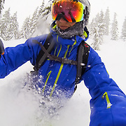 Tyler Hatcher skis in the backcountry of the Cascade Mountain Range near the boundaries of Mount Baker Ski Area.
