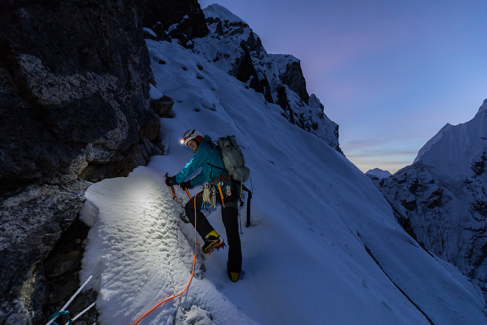 Quentin Roberts as day breaks on the mixed section of the SW Ridge of Cholatse in Nepal