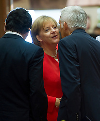 Angela Merkel, Germany's chancellor, center, is greeted by Jose Manuel, Barroso, president of the European Commission, left, and Jerzy Buzek, president of the European Parliament, during the European Summit meeting at EU Council headquarters in Brussels, Belgium, on Thursday, June 17, 2010. (Photo © Jock Fistick)