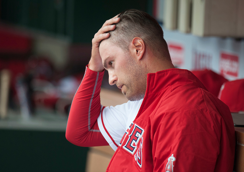 Angels' starting pitcher David Huff sits in the dugout after being taken out of the game in the second inning against the Cleveland Indians Sunday at Angel Stadium. Huff gave up five runs (two earned) in one and 2/3 innings.<br /> <br /> ///ADDITIONAL INFO:   <br /> <br /> angels.0612.kjs  ---  Photo by KEVIN SULLIVAN / Orange County Register  -- 6/12/16<br /> <br /> The Los Angeles Angels take on the Cleveland Indians Sunday at Angel Stadium.