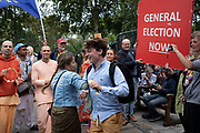 Brexit protesters dance with people from the Hare Krishna movement, whi came to College Green to spread some joy in Westminster on the day after Parliament voted to take control of Parliamentary proceedings and prior to a vote on a bill to prevent the UK leaving the EU without a deal at the end of October, on 5th September 2019 in London, England, United Kingdom. Yesterday Prime Minister Boris Johnson faced a showdown after he threatened rebel Conservative MPs who vote against him with deselection, and vowed to aim for a snap general election if MPs succeed in a bid to take control of parliamentary proceedings to allow them to discuss legislation to block a no-deal Brexit.
