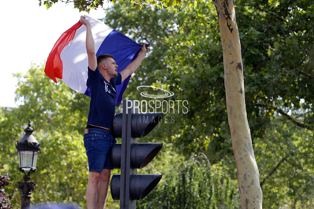 Fan during the parade of the team France on Champ-Elysées after winning the 2018 FIFA World Cup Russia on July 16, 2018 in Paris, France - Photo Frederic Le Floc'h / ProSportsImages / DPPI