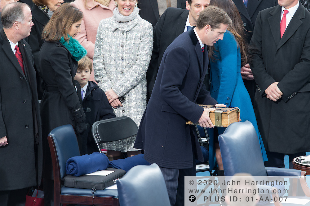 Beau Biden, son of Vice President Joe Biden carries the family bible in between sisters Naomi Biden and Ashley Biden at the 57th Presidential Inauguration of President Barack Obama at the U.S. Capitol Building in Washington, DC January 21, 2013.